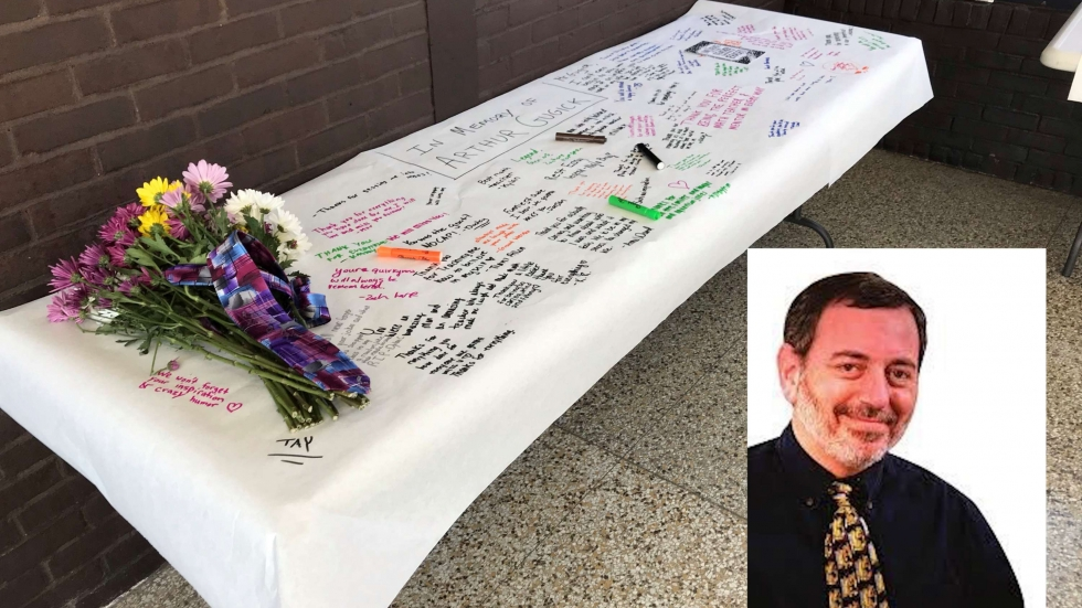 A table with flowers and words of condolences for Arthur Gugick at Beachwood High School.