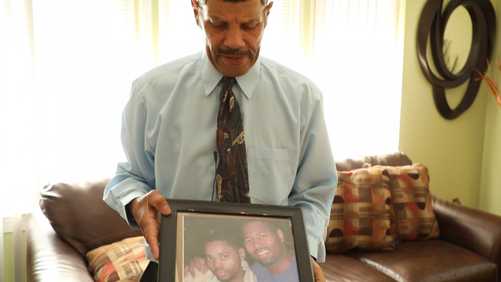 Darrick Wade shows a photo of his son, Demetrius, who was poisoned by lead as a child and passed away at the age of 24. (Photo: Ideastream / Mary Fecteau)