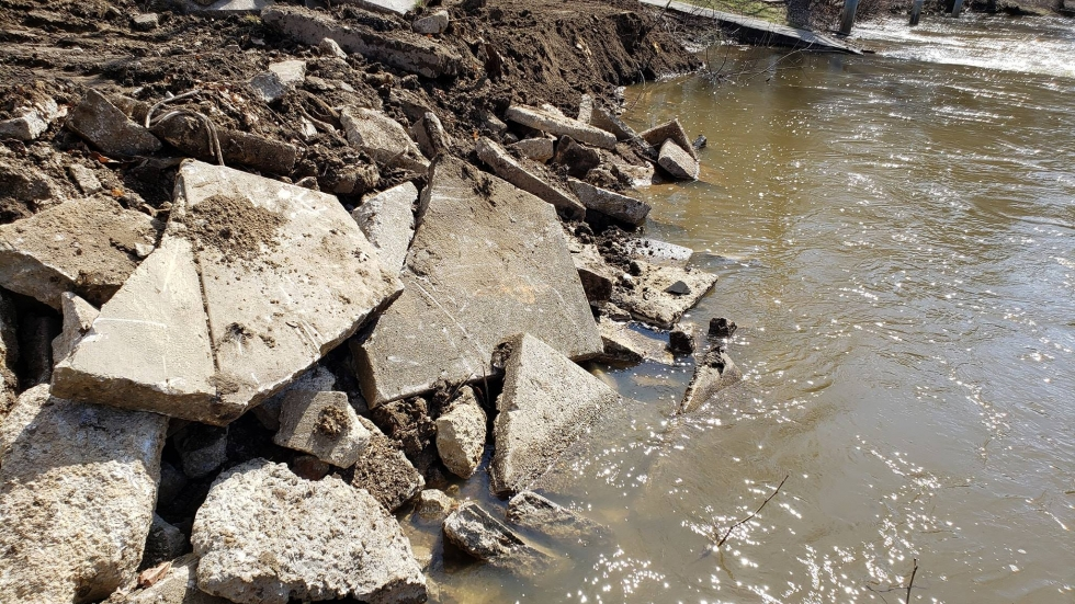 Broken chunks of concrete lay on the banks of the Cuyahoga River in Cuyahoga Falls.