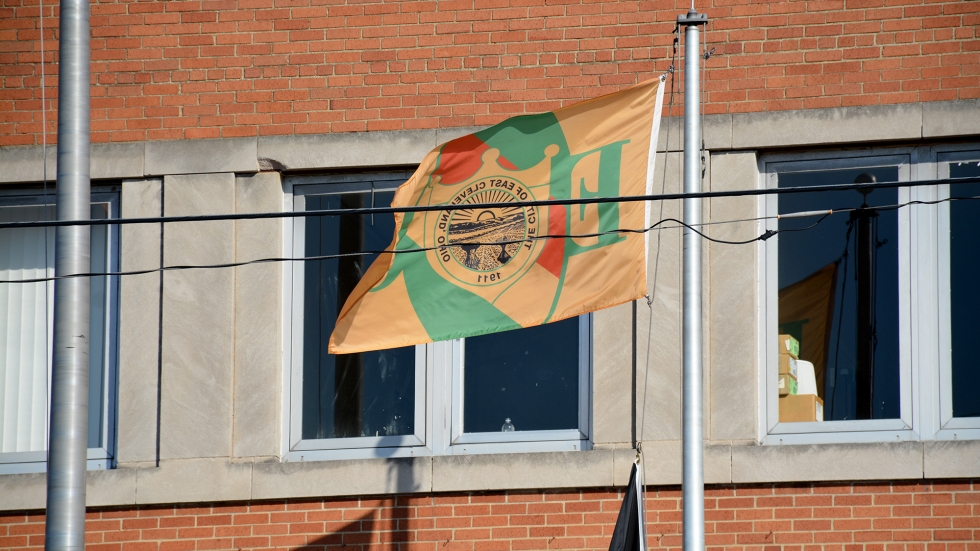 A flag flies outside East Cleveland city hall in 2015.