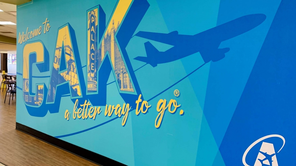 "A mural on a wall at Akron Canton markets the regional airport as ""a better way to go""."