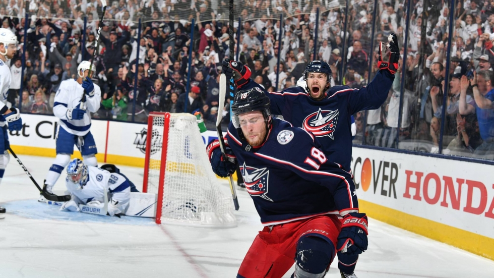 Pierre-Luc Dubois and Oliver Bjorkstrand celebrate one the Columbus Blue Jackets' seven goals in their playoff victory over the Tampa Bay Lightning.