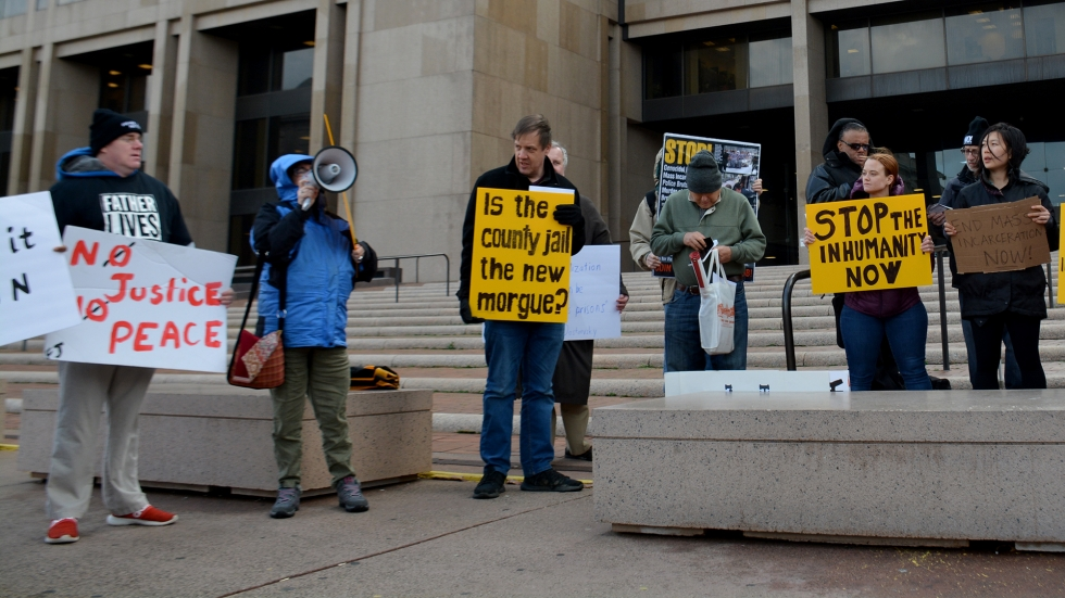 Demonstrators hold signs outside the Cuyahoga County Justice Center in January.