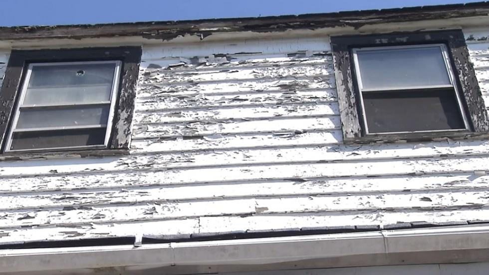 A house with chipping paint on the exterior