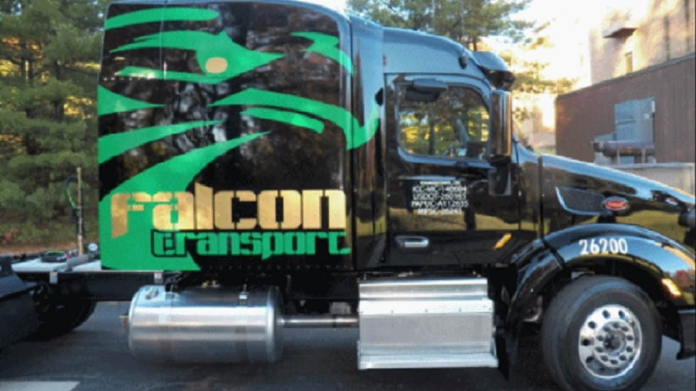 Tractor trailer with Falcon Transport logo.