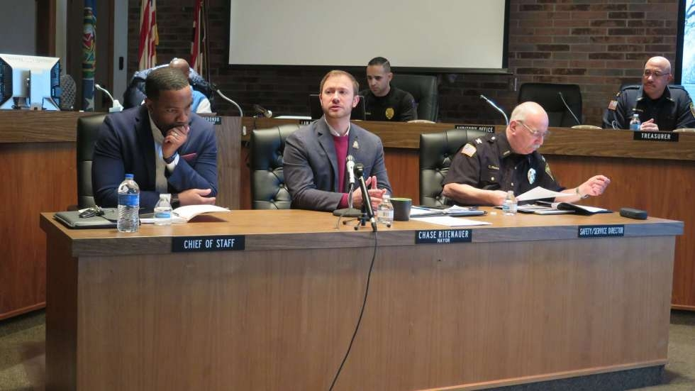 Lorain Mayor Chase Ritenauer, center, speaks at a January event with Lorain City Schools CEO David Hardy Jr., left, and Police Chief Cel Rivera, right.