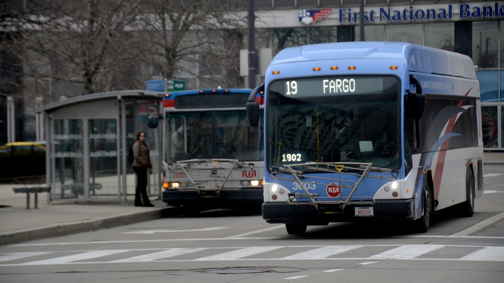 Two RTA buses drive near Public Square in downtown Cleveland.