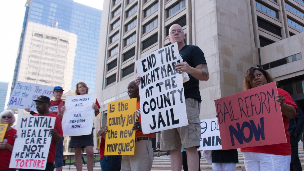 Activists demonstrate outside the Cuyahoga County Justice Center on Monday.