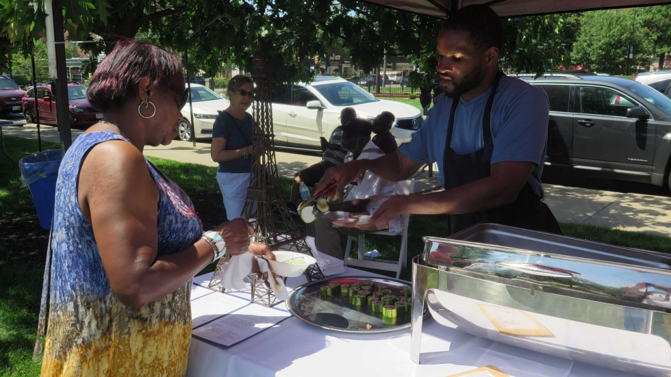 A booth for EDWINS Restaurant and Butcher Shop offered finger food at Sunday's community picnic.