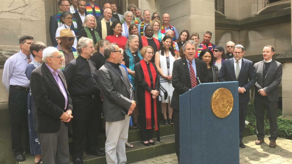 Local faith leaders joined Senator Brown to speak out against the Trump Administration's family separation policy. (Photo: Lecia Bushak / ideastream)