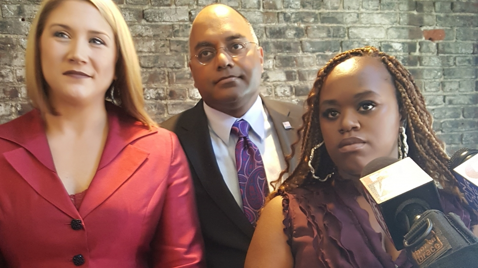 Lawyers Ashlie Case Sletvold and Subodh Chandra of The Chandra Law Firm LLC and their client, Chantelle Glass