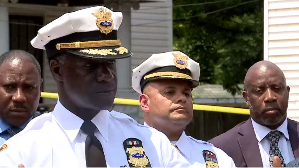 Police have a suspect in custody in connection with the quadruple homicide in Slavic Village, Cleveland Police Chief Calvin Williams (second from left) discussed the arrest at the scene of the crime Thursday.