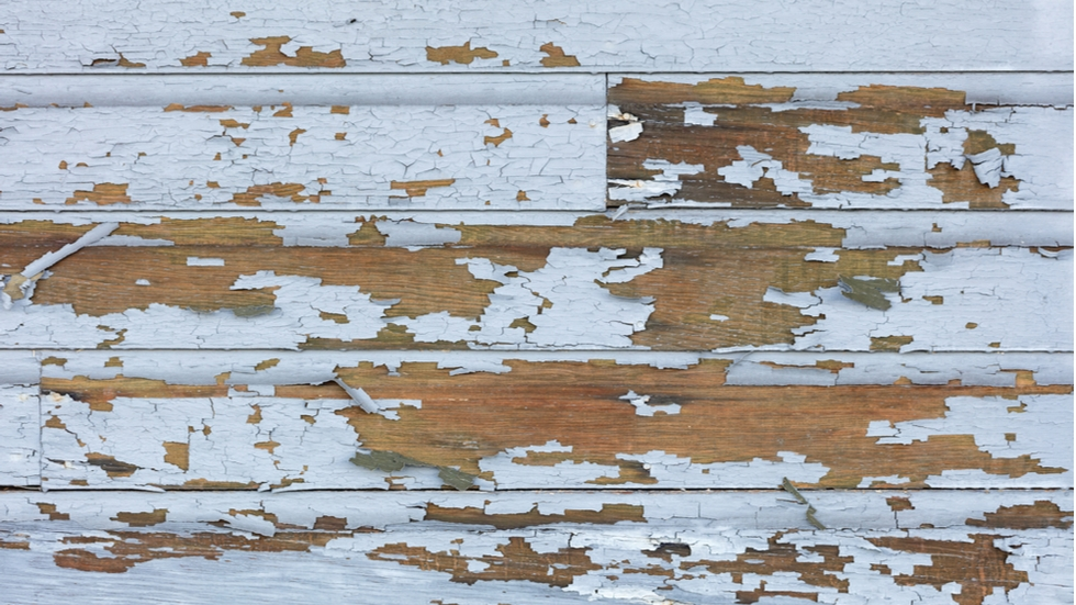 Cracked and peeling paint in older homes can pose a risk of lead poisoning.