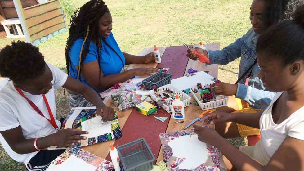 Teens work on a collage as part of Literary Lots, a summer pop-up for kids and families.