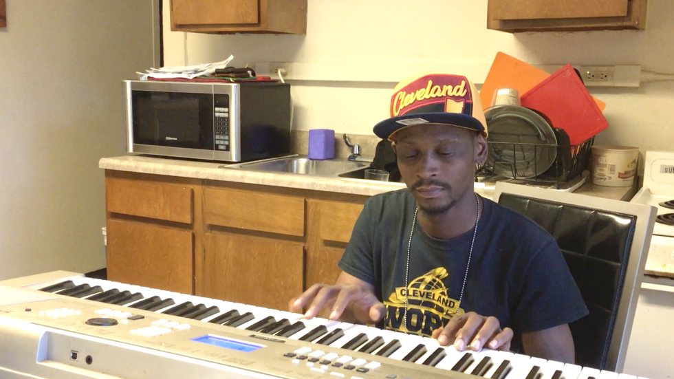 Jason Brewer plays an original composition on his keyboard at Woodhill Homes.
