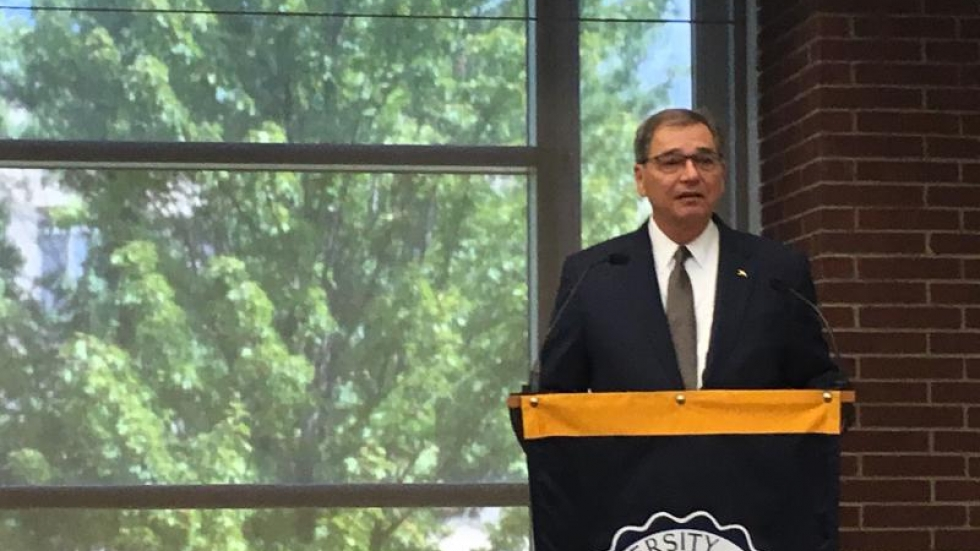 University of Akron's new president Gary L. Miller stands at a podium