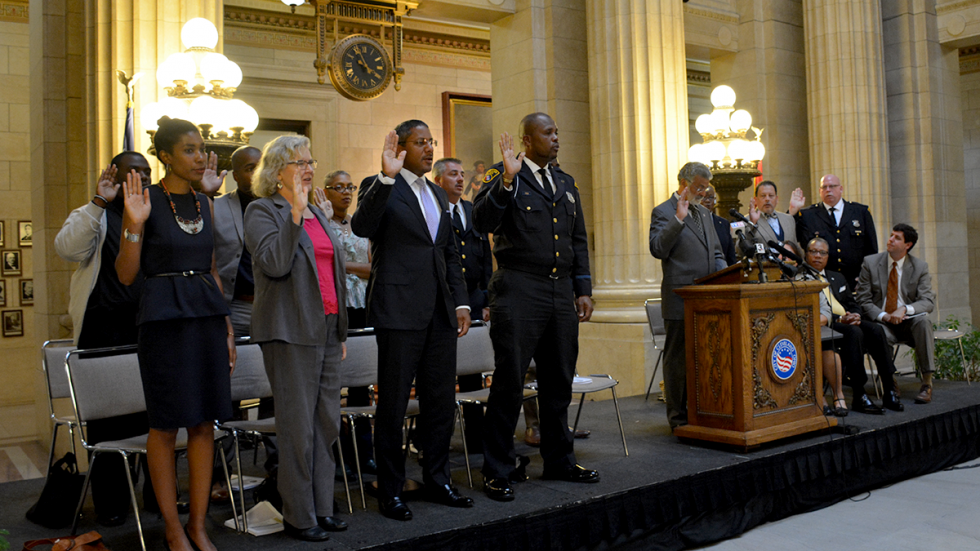 Cleveland Mayor Frank Jackson administers the oath of office to members of the Community Police Commission in 2015.