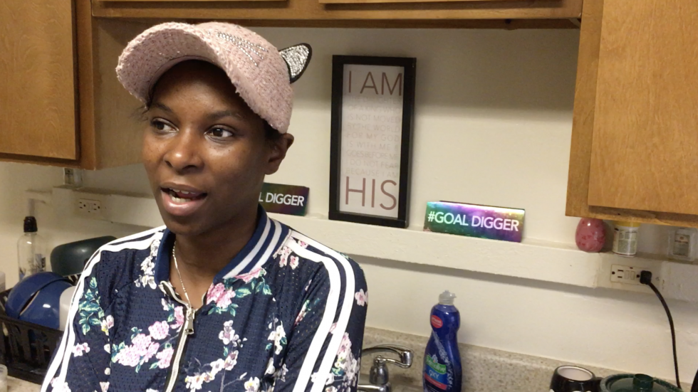 Quiana Baker stands in her apartment at Woodhill Homes.