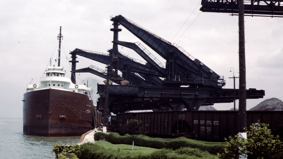 Huletts unload iron ore from the EAS Clarke of the Interlake Steamship Co. at the Pennsylvania Railroad ore docks in Cleveland in May 1943