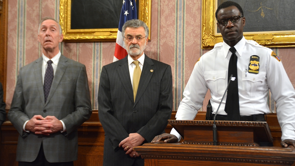 Safety Director Michael McGrath, left, Cleveland Mayor Frank Jackson and Police Chief Calvin Williams speak at a 2018 news conference.