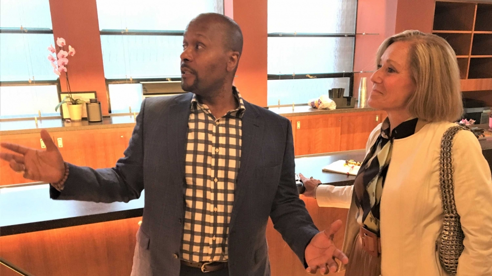 Karamu CEO Tony Sias gives Charna Sherman and other members of the CAC board a tour of his rejuvenated facility