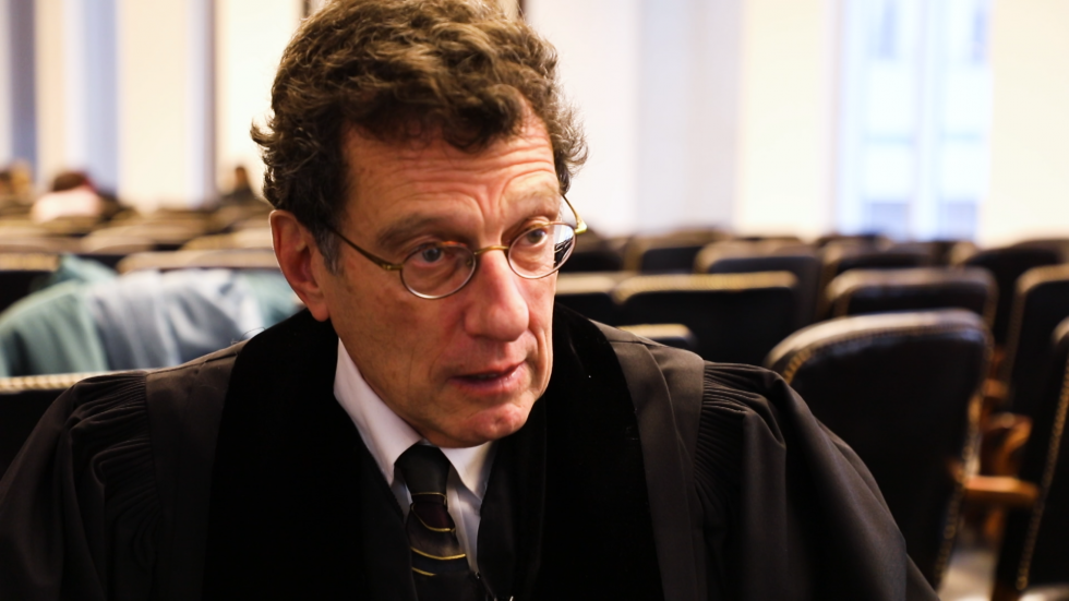U.S. District Judge Dan Polster, seen here in a file image from in a March interview at a naturalization ceremony, is overseeing more than 2,000 lawsuits over the opioid crisis.