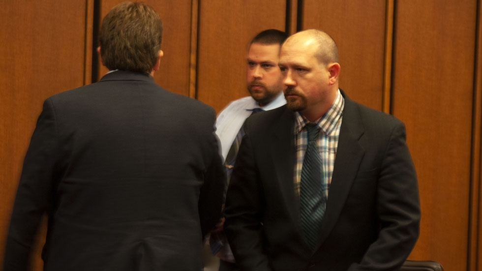 Jason Jozwiak (left) and John Wilson (right) leave the Cuyahoga County courtroom after the Sept. 25 verdict.