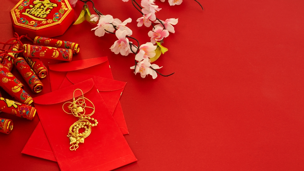photo of Chinese New Year money cards and fireworks [Shutterstock]