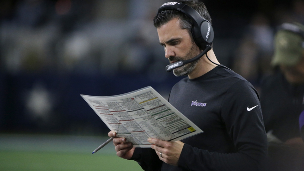 Minnesota Vikings offensive coordinator Kevin Stefanski looks at his offensive play sheet as they played the Dallas Cowboys during an NFL football game in Arlington, Texas, Sunday, Nov. 10, 2019.