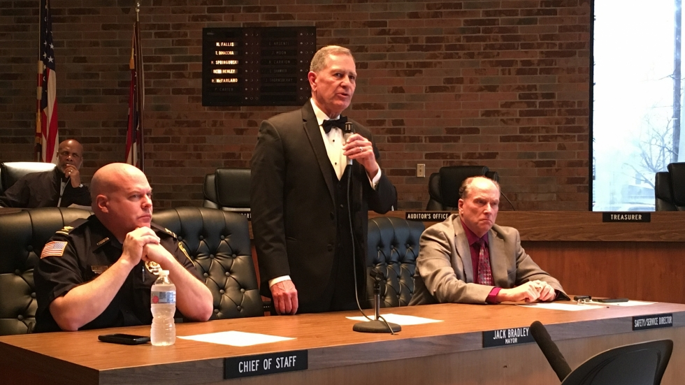 Lorain Mayor Jack Bradley (center) stands to address resident questions at Speak Up & Speak Out event. Police Chief James McCann (left) and Interim Lorain Schools CEO Greg Ring (right) sit beside him.