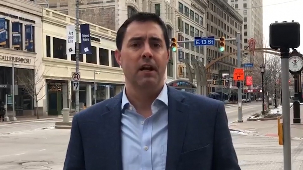 Secretary of State Frank LaRose standing at the corner of Euclid Avenue and 13th Street.