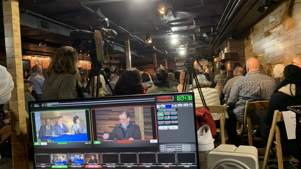 A video camera's view of panelists at The Sound of Ideas Community Tour on the future of the West Side Market.