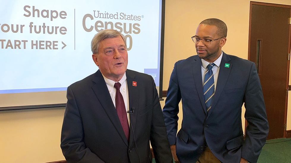 U.S. Census Bureau Director Steven Dillingham (L) and Elyria Mayor Frank Whitfield (R) in front of a slide reading United States Census 2020