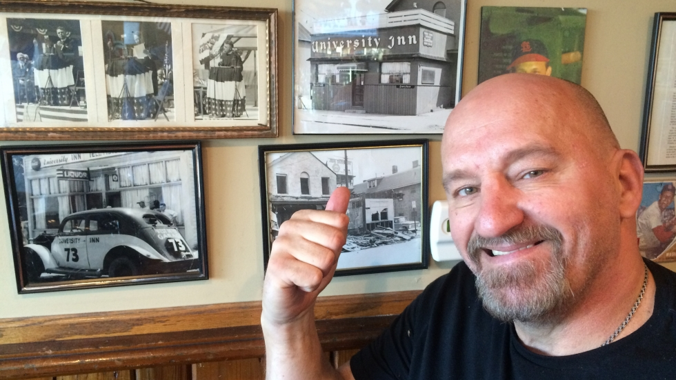 Bernie Sokolowski proudly points to pictures of his family on the restaurant walls