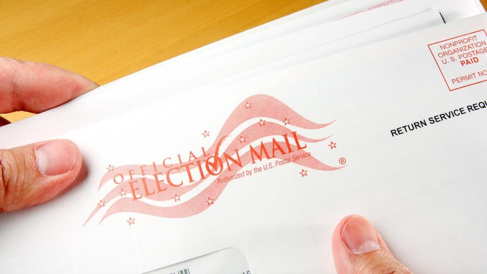 """An envelope reading """"official election mail."""""""