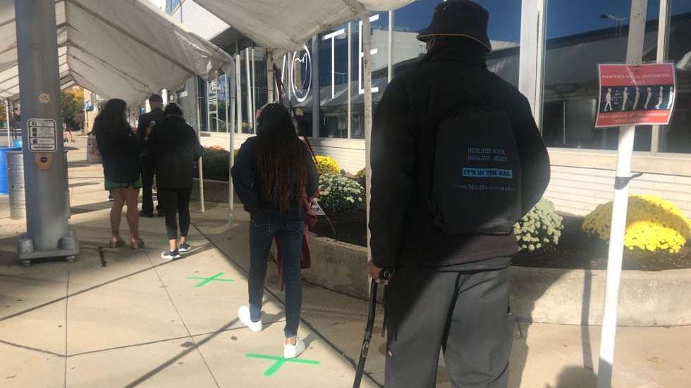 Voters line up for early in-person voting at the Cuyahoga County Board of Elections. But what if you are hospitalized and can't get there? [Lisa Ryan / ideastream]