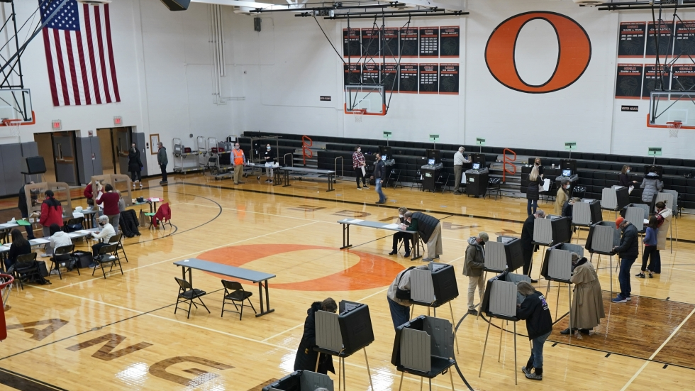 Voters cast their ballots on Election Day at Orange High School in Pepper Pike, Ohio, Tuesday, Nov. 3, 2020.
