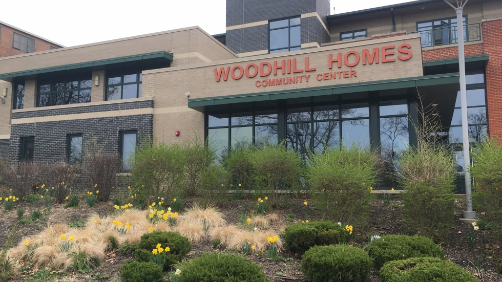A photo shows the Woodhill Homes Community Center in Cleveland.