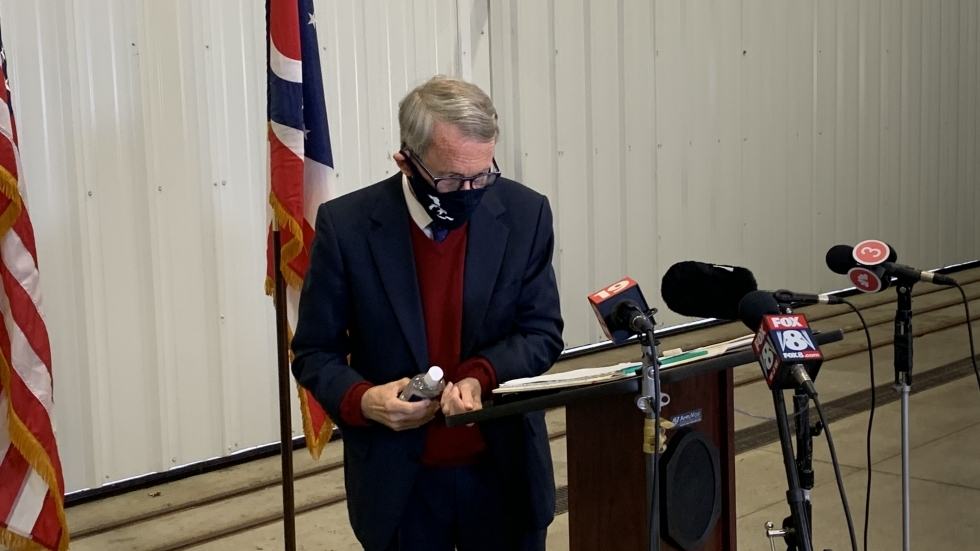Governor DeWine puts on hand sanitizer after a news conference at the Burke Lakefront Airport in Cleveland in October. A Kent State Univ. Professor says the measures he is proposing are astep in the right direction but arenot enough to keep Ohioans safe. [Anna Huntsman / ideastream]