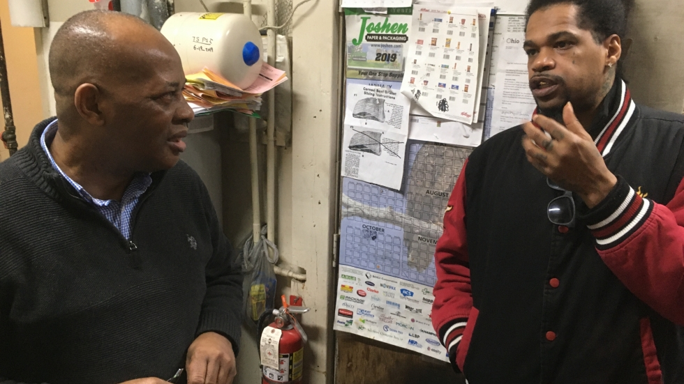 Julian Grossman (right) meets with an owner of Chillie's Beverage & Deli.