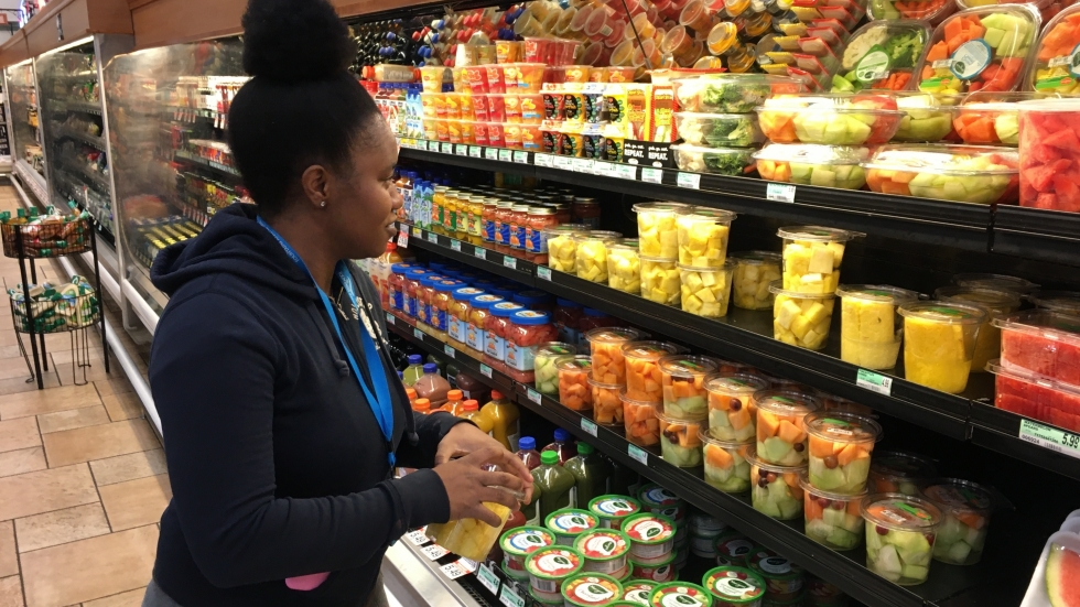 Shakira Collier stands in the produce section at Dave's Market on Shaker Square.