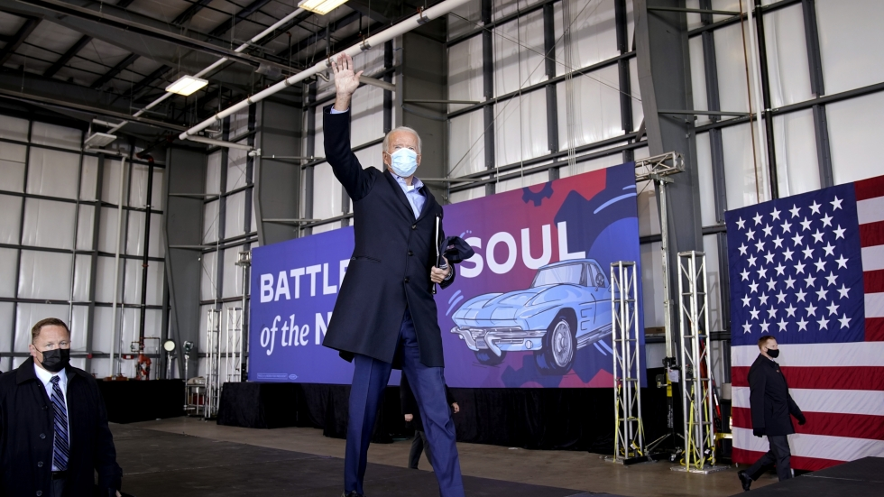 Then-Democratic presidential candidate Joe Biden waves after speaking at a rally at Cleveland Burke Lakefront Airport, Monday, Nov. 2 in Cleveland