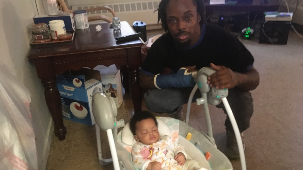 Tywonge Watkins poses with his daughter Champayne at Woodhill Homes in Cleveland.