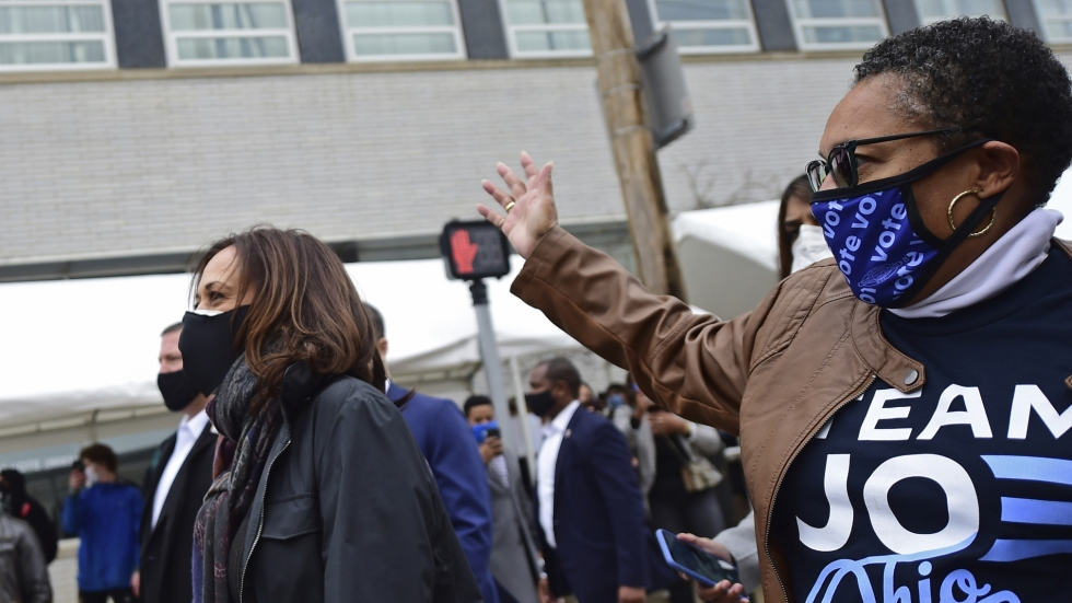 Democratic vice presidential candidate Sen. Kamala Harris (D-Calif.) walks with Rep. Marcia Fudge (D-Ohio) outside the Cuyahoga County Board of Elections during a campaign event on Saturday, Oct. 24, 2020. [David Dermer / AP]