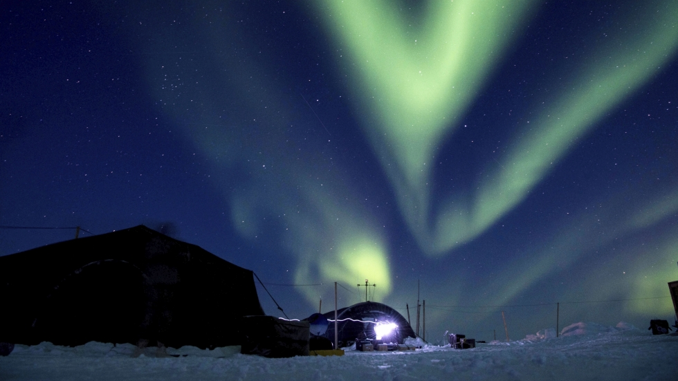 The Northern Lights over a U.S. Navy training site in the Beaufort Sea.