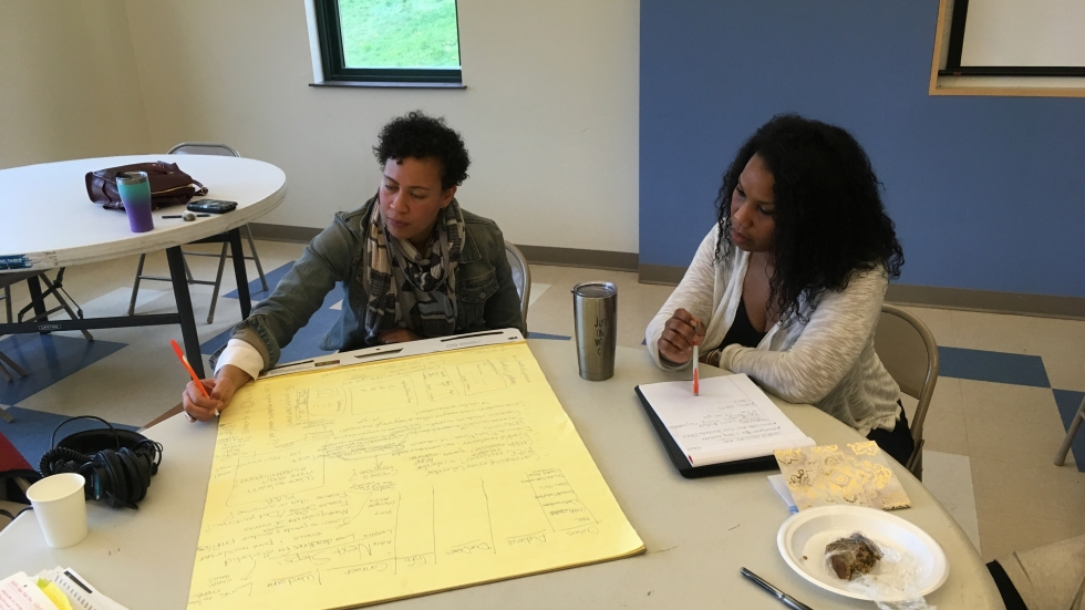Indigo Bishop and Lashawna Adams-Mitchell of CMHA brainstorm future plans for Woodhill Homes.