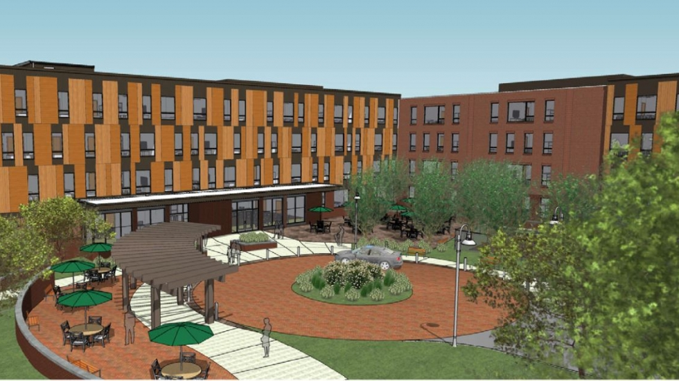 An architectural rendering shows an early phase of Woodhill Homes' redevelopment.