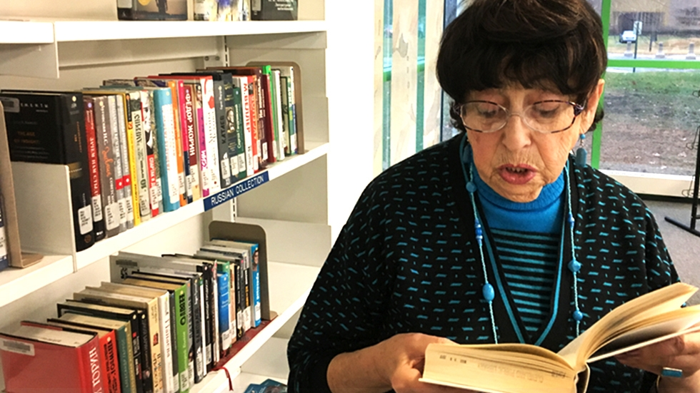Irina Parkman reads from a book at a Cleveland Public Library branch.