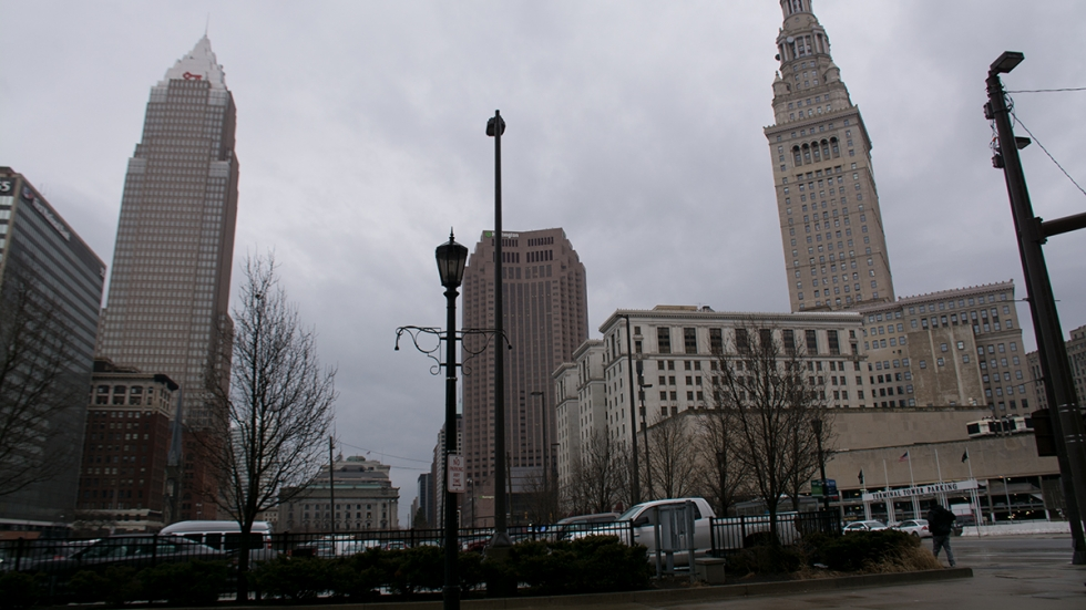 one of the parking lots currently on the site of what will be the new Sherwin-Williams headquarters with Cleveland's skyline in the background.
