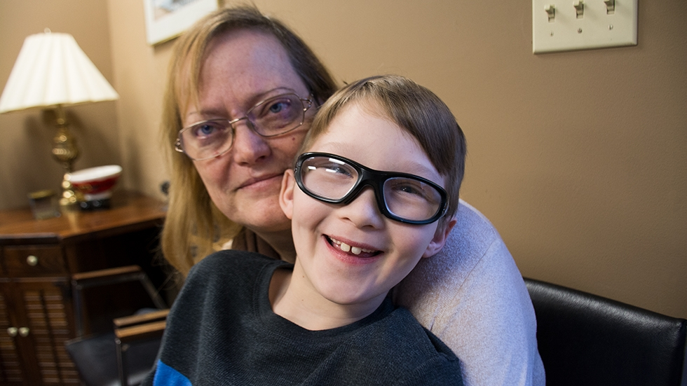 Michele Rout and her grandson, Gabe, pose for a photo in their attorney's office in Chillicothe.